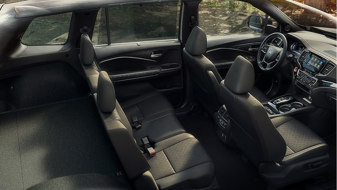 Full interior shot of the 2019 Honda Passport Elite in Black Leather displaying spacious interior and cargo capacity.