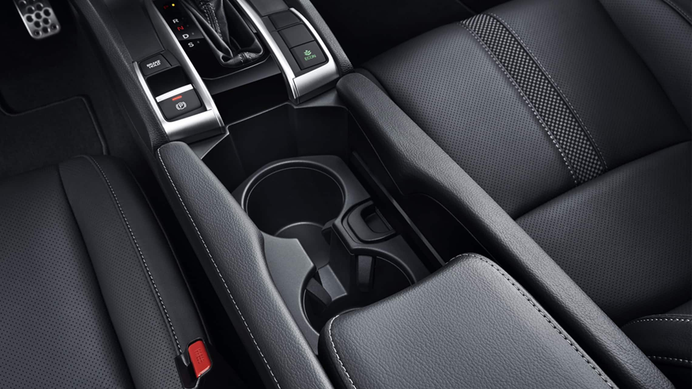 Detail of beverage holders in 2020 Honda Civic Sport Touring Hatchback.